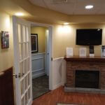 Dental clinic door and T.V. mount on wall