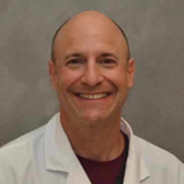 Dr. Mandelbaum, DMD, FICD
